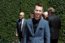 Christopher Scott arrives for the 2014 Primetime Creative Arts Emmys.