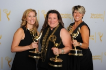 Alexa L. Fogel (left), Christine Kromer and Meagan Lewis celebrate their win at the 2014 Primetime Creative Arts Emmys.