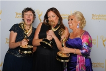 Stephanie Gorin (left), Rachel Tenner and Jackie Lind celebrate at the 2014 Primetime Creative Arts Emmys.
