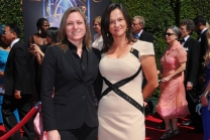 Cindy Holland (left) and guest arrive for the 2014 Primetime Creative Arts Emmys.