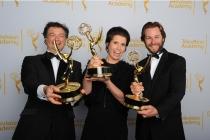 Paul Ghirardani, Deborah Riley and Rob Cameron celebrate their win at the 2014 Primetime Creative Arts Emmys.