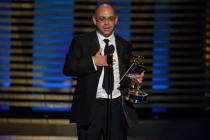 Editor Peter Chakos of The Big Bang Theory accepts an award at the 2014 Primetime Creative Arts Emmys.