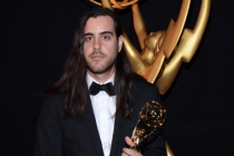 Sean Szeles celebrates at the 2014 Primetime Creative Arts Emmys.