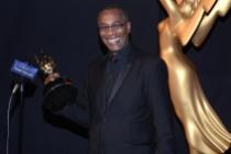 Joe Morton of Scandal celebrates his win at the 2014 Primetime Creative Arts Emmys.
