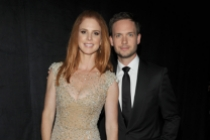 Sarah Rafferty (l) and Patrick J. Adams (r) of Suits at the 2014 Primetime Creative Arts Emmys.