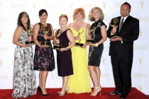 The Saturday Night Live hairstyling team celebrates their win at the 2014 Primetime Creative Arts Emmys.