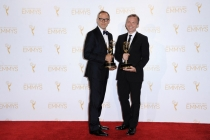 Saturday Night Live costume designers Tom Broecker (l) and Eric Justian (r) celebrate their win at the 2014 Primetime Creative Arts Emmys.