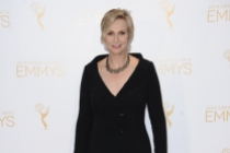 Jane Lynch celebrates her win for Hollywood Game Night at the 2014 Primetime Creative Arts Emmys.