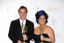 The Oscars art direction team members Derek McLane (l) and Gloria Lamb (r) celebrate their win at the 2014 Primetime Creative Arts Emmys.
