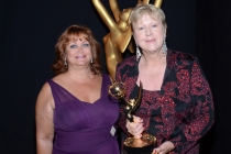 Yoneet Solange (l) and Susan Noll (r) celebrate their win at the 2014 Primetime Creative Arts Emmys.