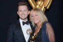 Downton Abbey hairstylists Adam James Phillips (l) and Magi Vaughan (r) celebrate their win at the 2014 Primetime Creative Arts Emmys.
