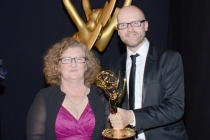 Game of Thrones makeup artist Jane Walker (l) and prosthetic designer Barrie Gower (r) celebrate their win at the 2014 Primetime Creative Arts Emmys.