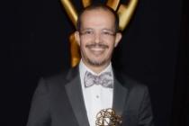 Pablo Munguia celebrates at the 2014 Primetime Creative Arts Emmys.