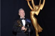 Dima Malanitchev celebrates at the 2014 Primetime Creative Arts Emmys.