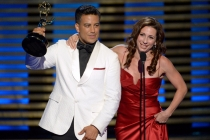 Choreographers Napoleon D'umo (l) and Tabitha D'umo (r) of So You Think You Can Dance accept an award at the 2014 Primetime Creative Arts Emmys.