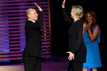 Paul Scheer (l) presents Hollywood Game Night host Jane Lynch (r) with an award at the 2014 Primetime Creative Arts Emmys.