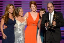 The makeup team for Saturday Night Live accepts an award at the 2014 Primetime Creative Arts Emmys.