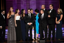 The Shark Tank team accepts an award at the 2014 Primetime Creative Arts Emmys.