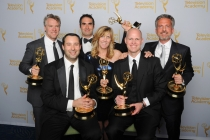 Tate Donovan (l) and the 30 For 30 Shorts team celebrate their win at the 2014 Primetime Creative Arts Emmys.