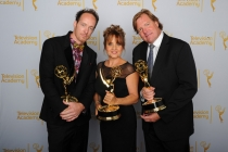 Dancing With the Stars camera operators Seth Saint Vincent (l), Bettina Levesque (c) and Mike Malone (r) celebrate their win at the 2014 Primetime Creative Arts Emmys.