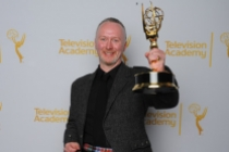 Neville Kidd celebrates at the 2014 Primetime Creative Arts Emmys.