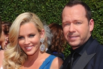 Jenny McCarthy and Donnie Wahlburg of Wahlburgers arrive for the 2014 Primetime Creative Arts Emmys.