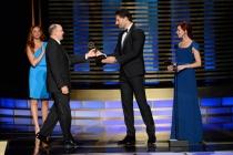 The Blacklist stunt coordinator Cort L. Hessler III (l) accepts an award from Joe Manganiello (c) and Carrie Preston (r) at the 2014 Primetime Creative Arts Emmys.