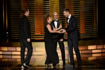 Dancing With the Stars camera operators Seth Saint Vincent (l) and Bettina Levesque accept an award from Jim Rash and Joel McHale (r) at the 2014 Primetime Creative Arts Emmys.