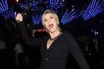 Hollywood Game Night winner Jane Lynch celebrates at the 2014 Creative Arts Emmys ball.