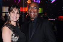 Christine Lietz (l) and Scandal winner Joe Morton (r) celebrate at the 2014 Creative Arts Emmys ball.