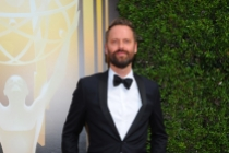 Dustin O'Halloran arrives on the red carpet at the Creative Arts Emmy Awards 2015.