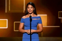 Gina Rodriguez presents an award at the 2015 Creative Arts Emmys.