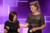 The team of Downton Abbey accepts their award at the 2015 Creative Arts Emmys.