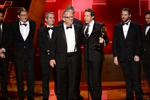 """The team of """"Game of Thrones"""" accepts their award at the Creative Arts Emmy Awards."""