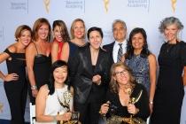 Rachel Darville, Becky Swanson, Shaina Holtz, kathryn Hempel, A. J. Hassan, Jonathan Gribetz, Karuna Rawal, Allison Amon, Judy John, and Lauren Greenfield backstage at the 2015 Creative Arts Emmy Awards.