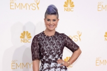 Kelly Osbourne of Fashion Police arrives at the 66th Emmy Awards.