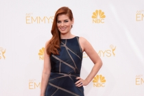 Debra Messing arrives at the 66th Emmy Awards.