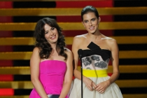 Zooey Deschanel (l) of New Girl and Allison Williams (r) of Girls present an award at the 66th Emmy Awards.