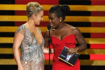 Hayden Panettiere (l) of Nashville and Uzo Aduba (r) of Orange is the New Black present an award at the 66th Emmys.
