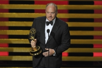 Louis C.K. accepts the award for outstanding writing for a comedy series for his work on Louie at the 66th Emmys.