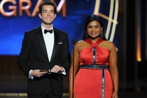 John Mulaney (l) and Mindy Kaling of The Mindy Project present an award at the 66th Emmy Awards.