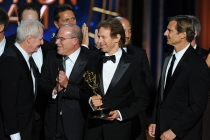 Jerry Bruckheimer (second from right) and the producers of The Amazing Race accept an award at the 66th Emmys.