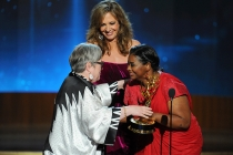 Kathy Bates (l) of American Horror Story: Coven accepts an award from Allison Janney (c) and Octavia Spencer (r) at the 66th Emmy Awards.