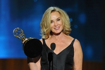 Jessica Lange of American Horror Story: Coven accepts an award at the 66th Emmy Awards.
