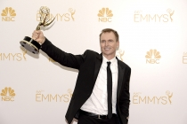 Phil Keoghan of The Amazing Race celebrates at the 66th Emmys.