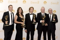 Jerry Bruckheimer (c) and the producers of The Amazing Race celebrate at the 66th Emmys.
