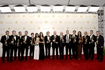 The producers of The Amazing Race celebrate at the 66th Emmy Awards.
