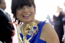 Gail Mancuso of Modern Family celebrates backstage at the 66th Emmys.