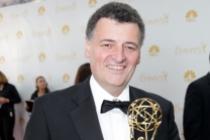 Sherlock writer Steven Moffat celebrates his win at the 66th Emmy Awards.