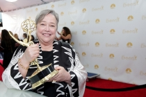 Kathy Bates of American Horror Story: Coven celebrates her win at the 66th Emmy Awards.